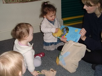 Holmsdale Manor Nursery Ibstock Staff reading to children
